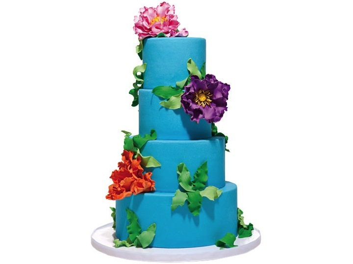 Bright wedding cake adorned with tropical flowers