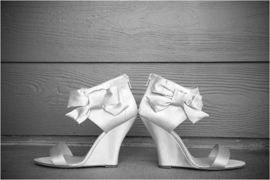 Chic ivory satin open toe bridal heels with feminine bow detail