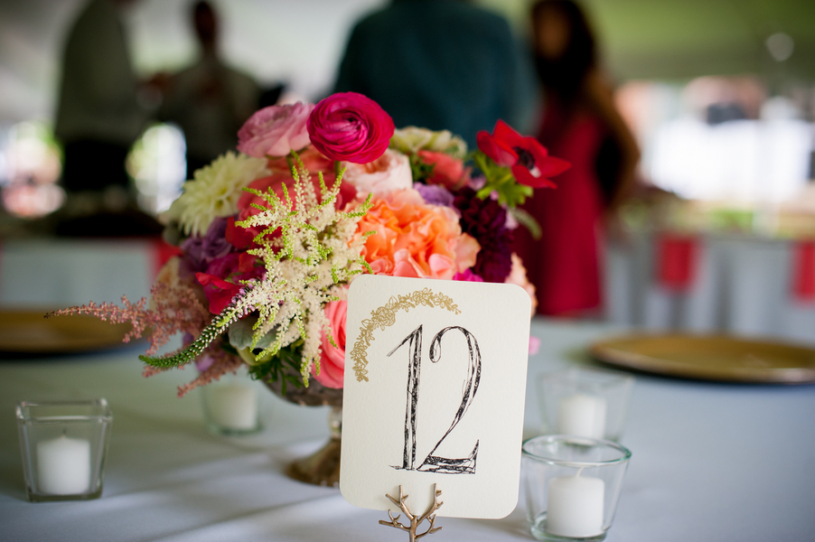 Stationary_table_number_and_simple_bright_centerpiece.full