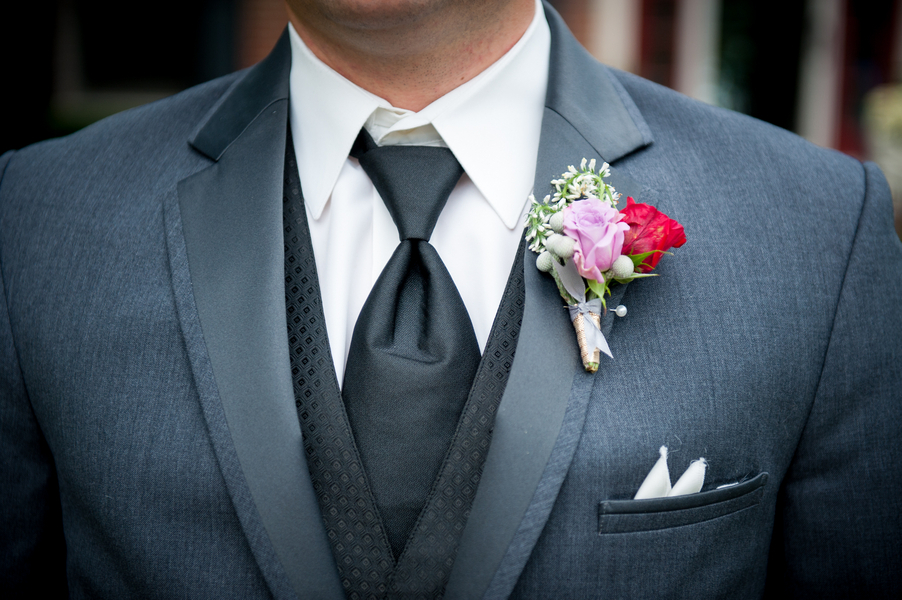 Groom_in_classic_grey_tux_and_boutonniere.full