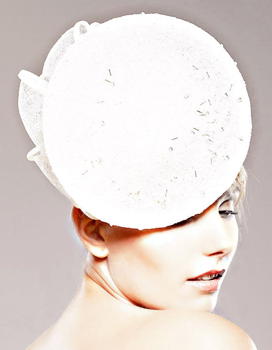 Chic white wedding hat with beading and bow detail inspired by the royal wedding
