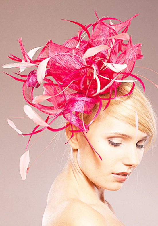 Dramatic cotton candy pink feather headpiece for wedding guests with lots of volume