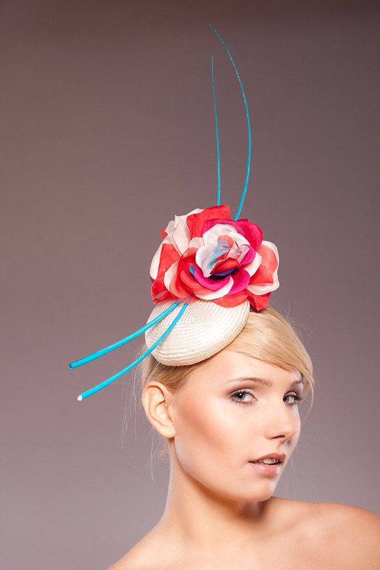 Vibrant turquoise, coral and red wedding guest couture hat like seen at the Royal Wedding