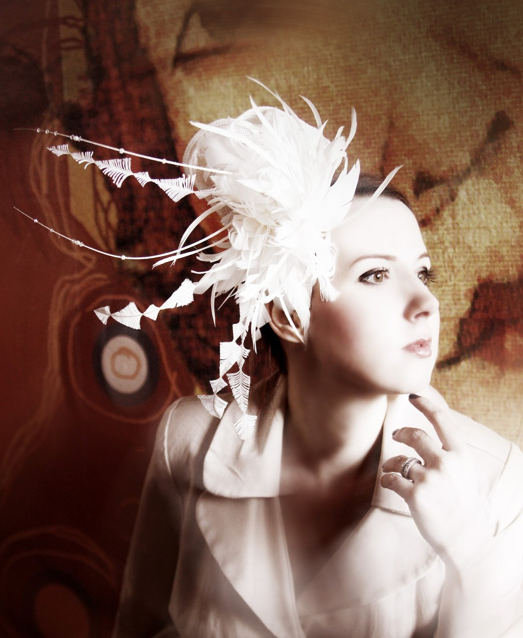 Haute couture ivory wedding hat with French net veil and feather details