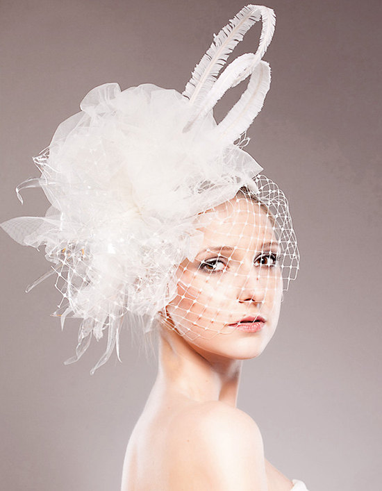 Haute couture white wedding fascinator with French net veil and feather details
