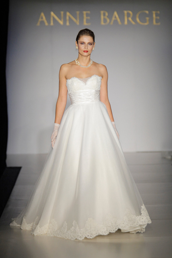 White sweetheart neckline full a-line Anne Barge wedding dress with satin cumberbund and lace embell