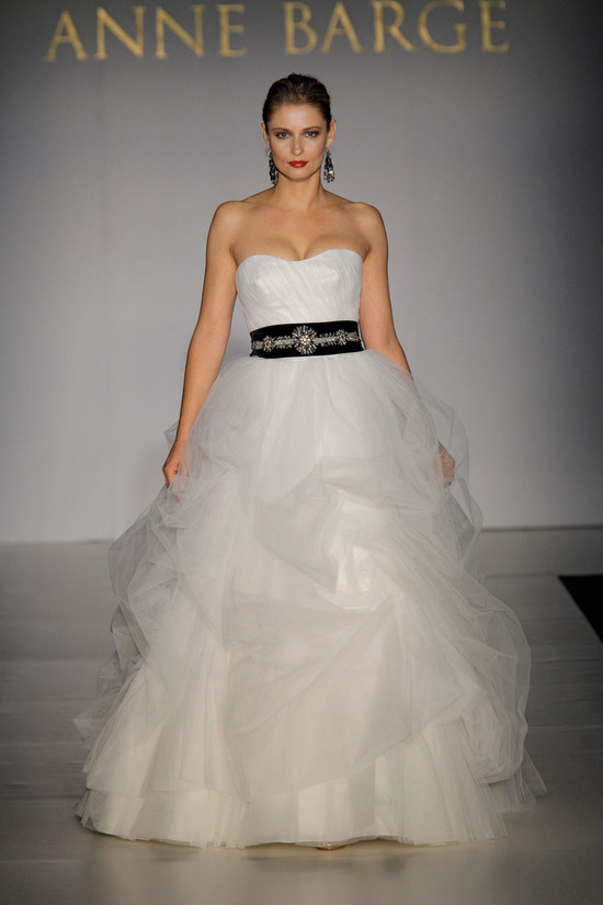 White voluminous tulle ball gown with sweetheart neckline and black sash by Anne Barge, Fall 2011