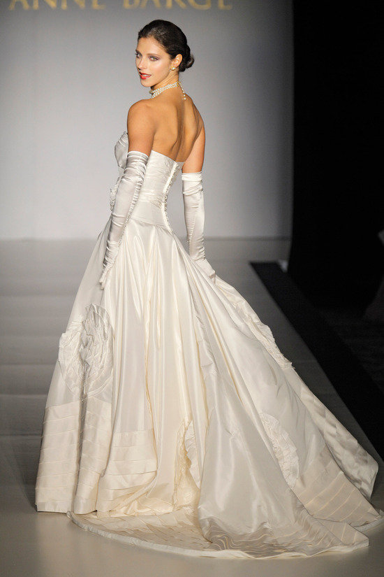 Regal duchess satin strapless bridal ball gown with covered buttons and high, vintage chic bridal gl