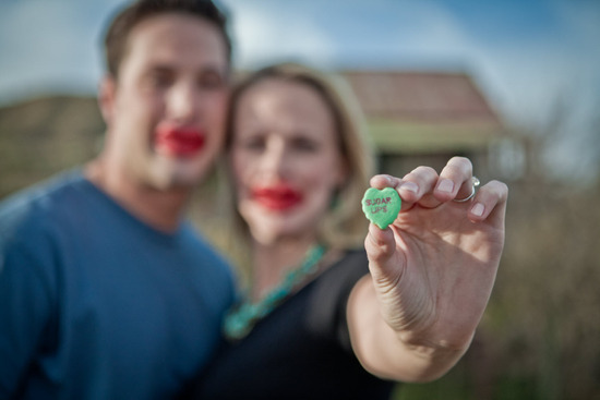 Casual outdoor engagement session in Arizona- bride and groom use candy sweethearts as props