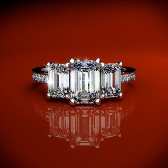 Three stone emerald cut diamond and platinum engagement ring like Kim Kardashian's