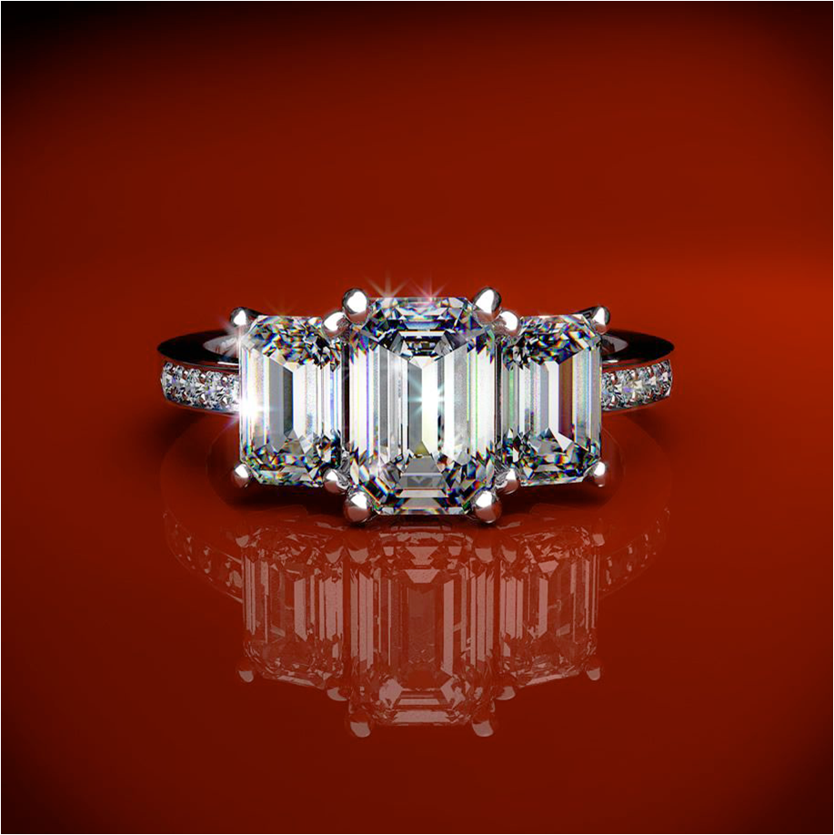 Three stone emerald cut diamond and platinum engagement ring like Kim Kardash
