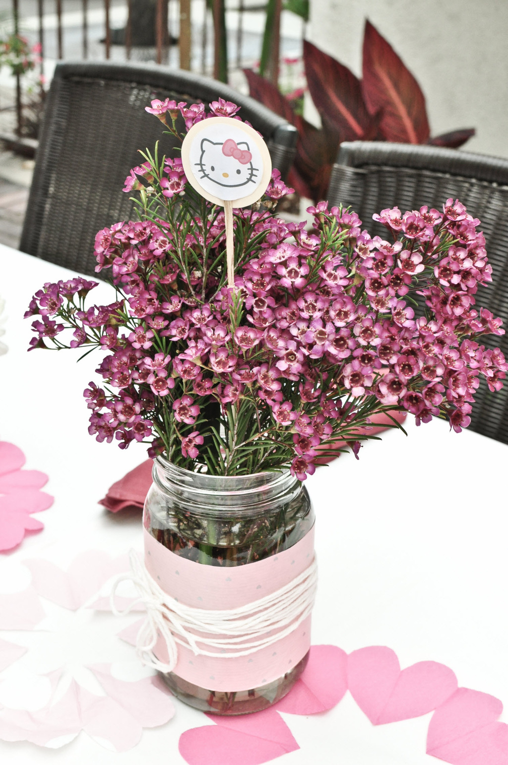 Simple diy wedding flower centerpiece with pink wax flowers in