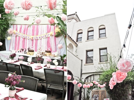Courtyard venue in california adorned with light pink and white decorations and flowers