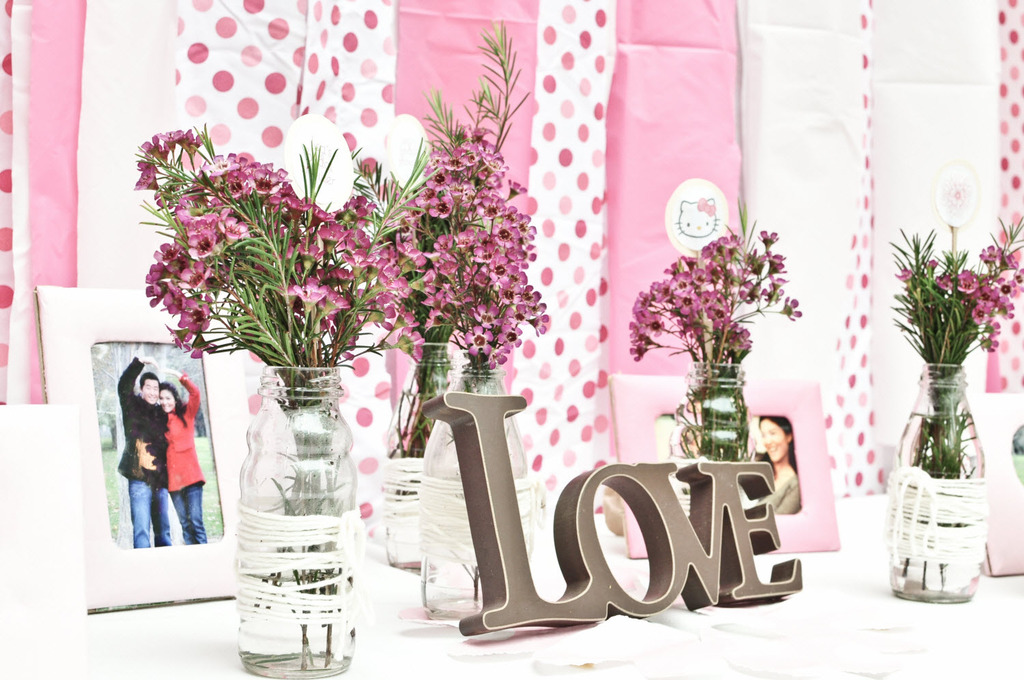 pink polka dot backdrop with romantic escort card table at california bridal shower