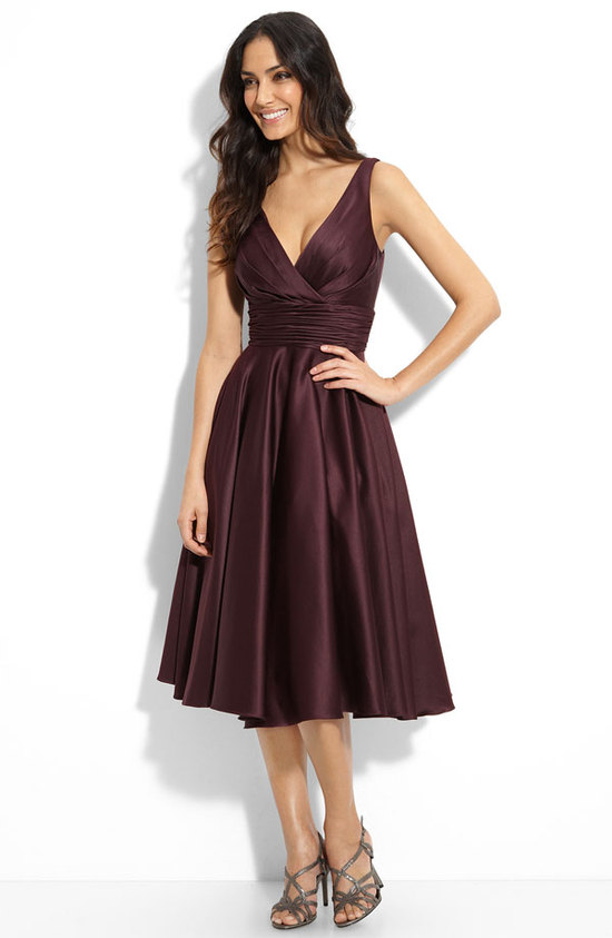 Deep v-neck maroon bridesmaid dress with full tea length skirt