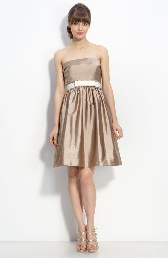 Chic champagne strapless bridesmaid dress with white belt by Monique Lhuillier