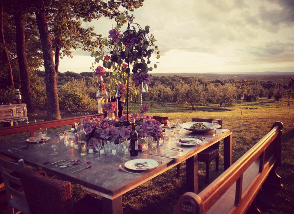 Outdoor_square_reception_table_with_purple_centerpiece.full