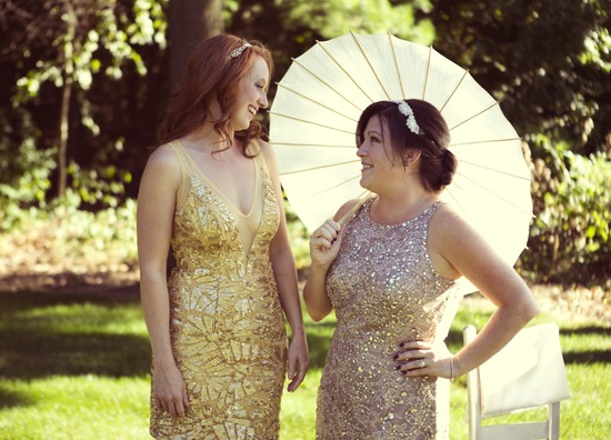 Silver and gold sequined bridesmaids dresses with parasol