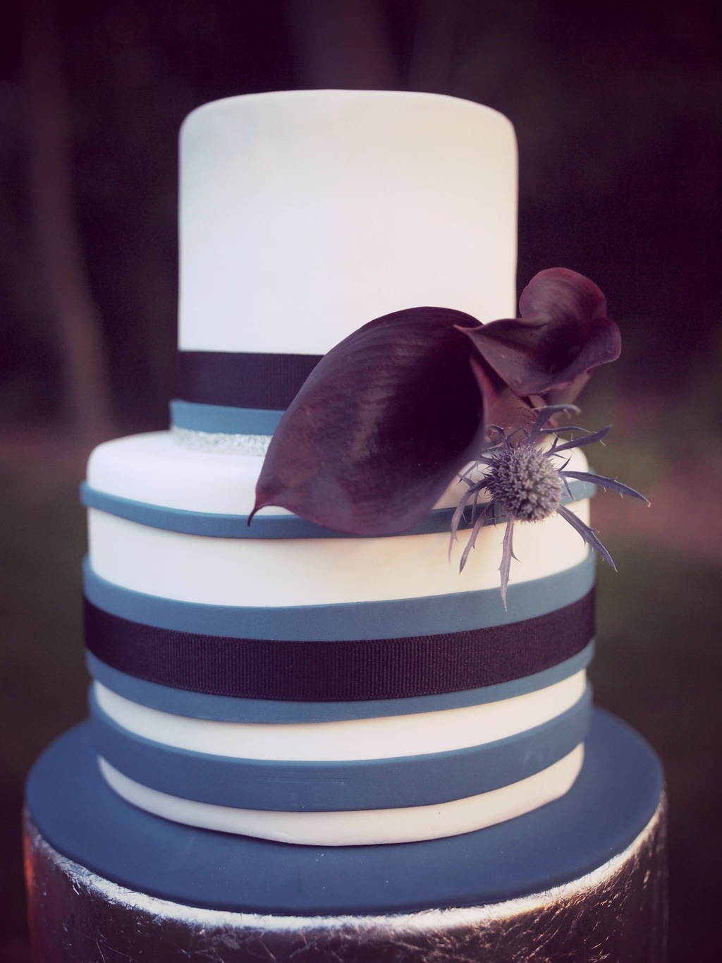 Two_tiered_purple_and_blue_stripped_wedding_cake.full