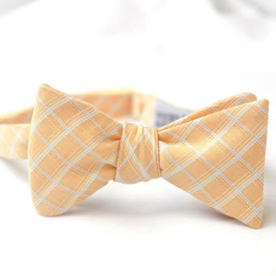 Muted peach and white patterned groom's bow tie for elegant spring or summer wedding