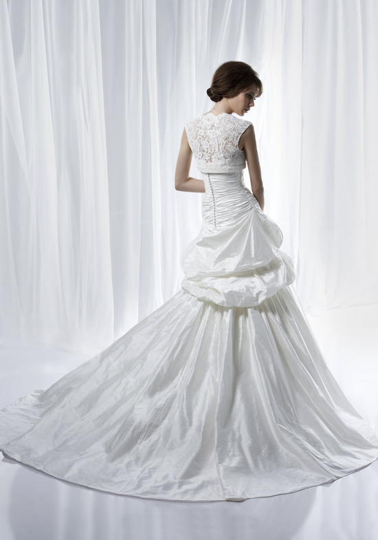 Dramatic and timeless wedding dress by Anjolique with sheer lace cap sleeved bolero