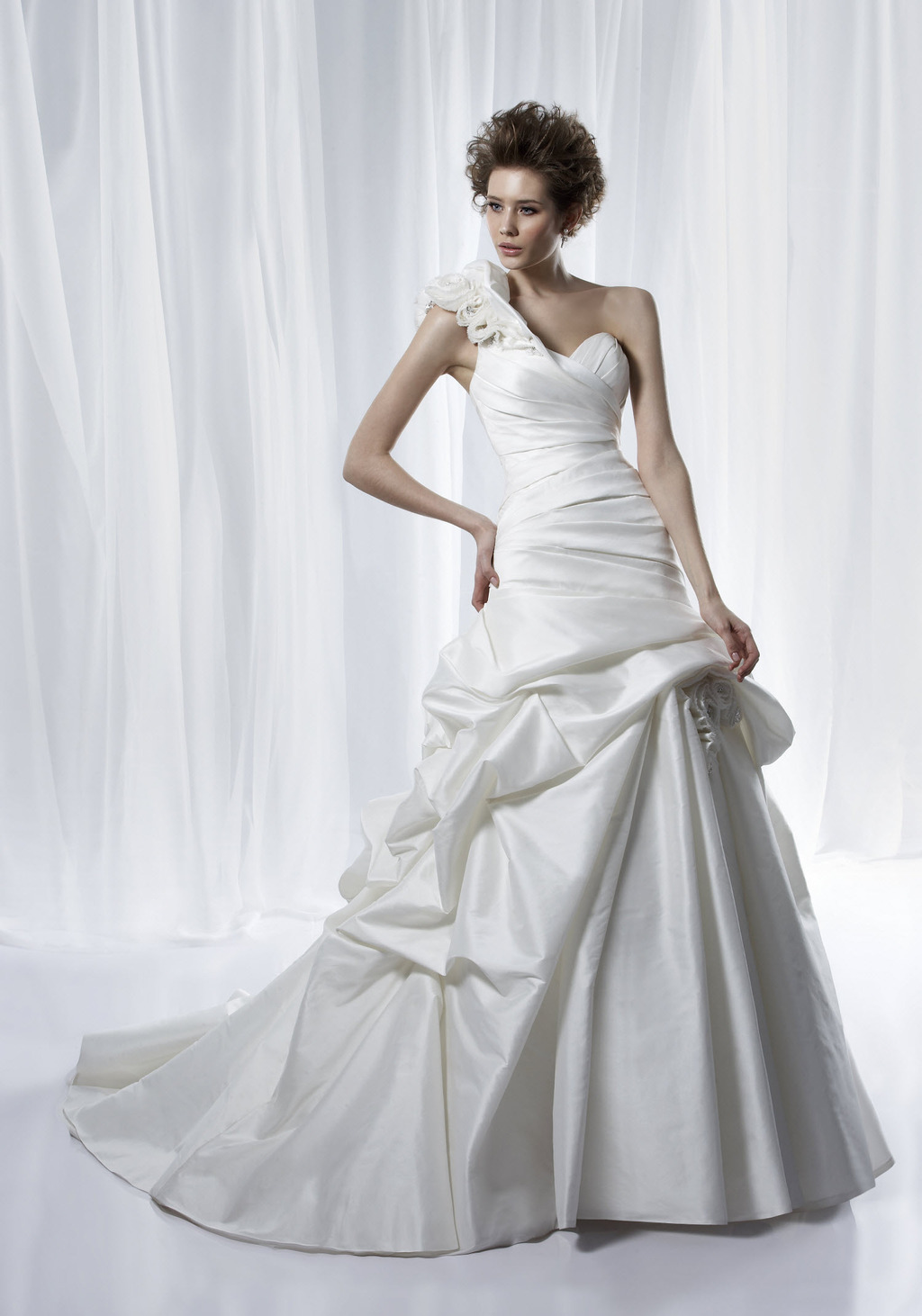 Classic one-shoulder ivory drop-waist ball gown wedding dress with modern bustle