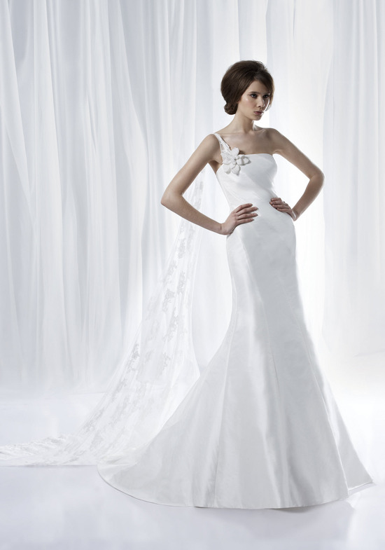 Perfect for the chic beach bride, this white mermaid wedding dress with one-shoulder and lace train