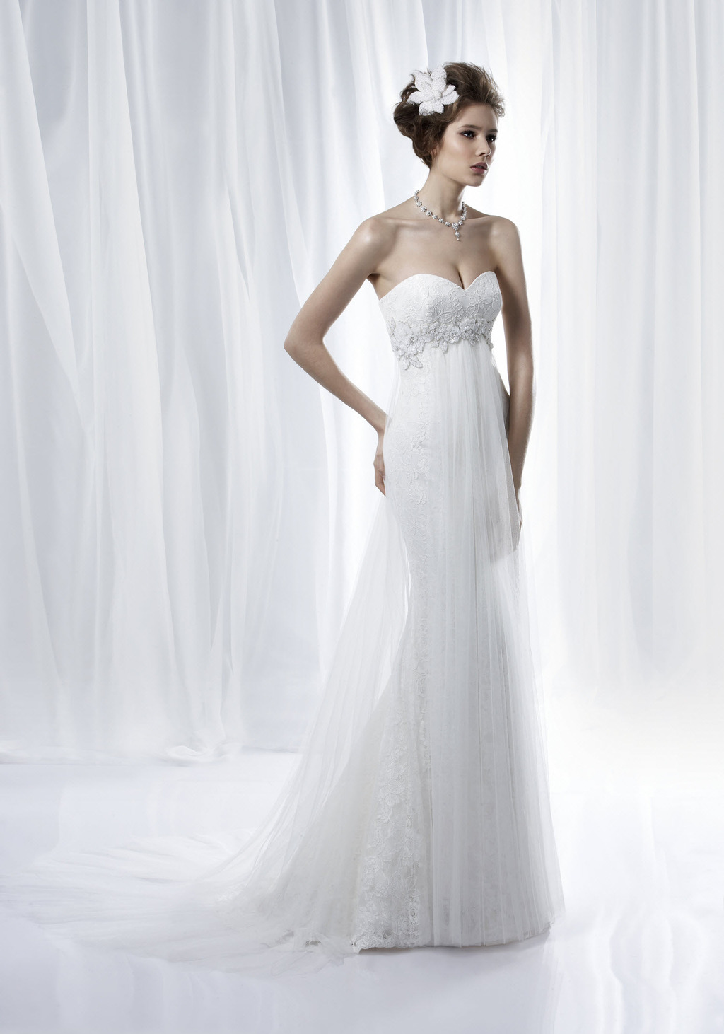 Ivory sweetheart neckline sheath/column wedding dress with lace-embellished bodice and sheer tulle o