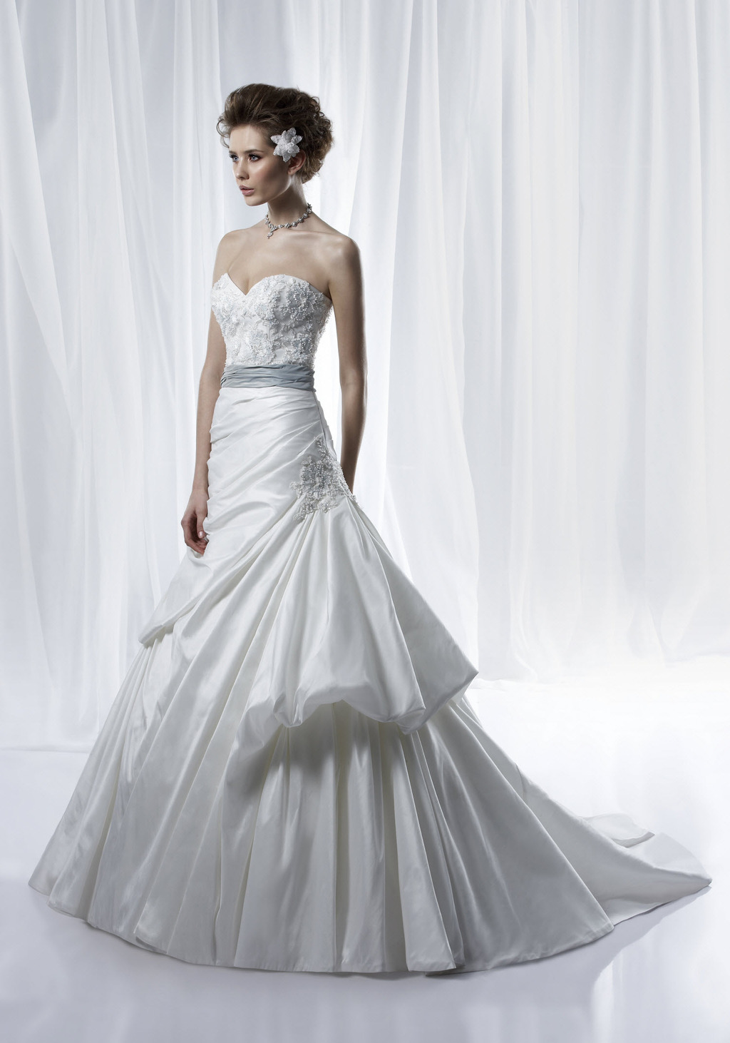 Ivory Sweetheart Ball Gown Wedding Dress With Modern Bustle And Silk Bridal Sash