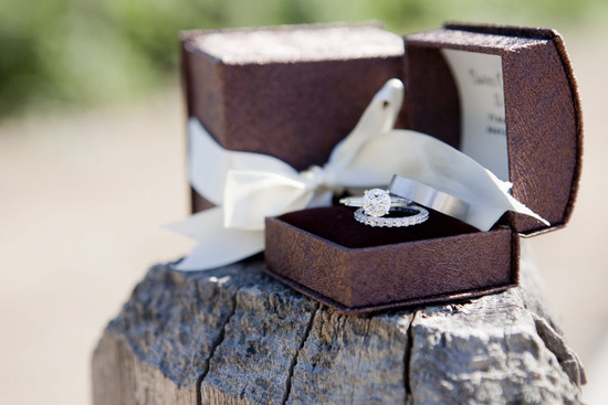 Dazzling platinum and diamond engagement ring in chocolate brown jewelry box with ivory satin ribbon