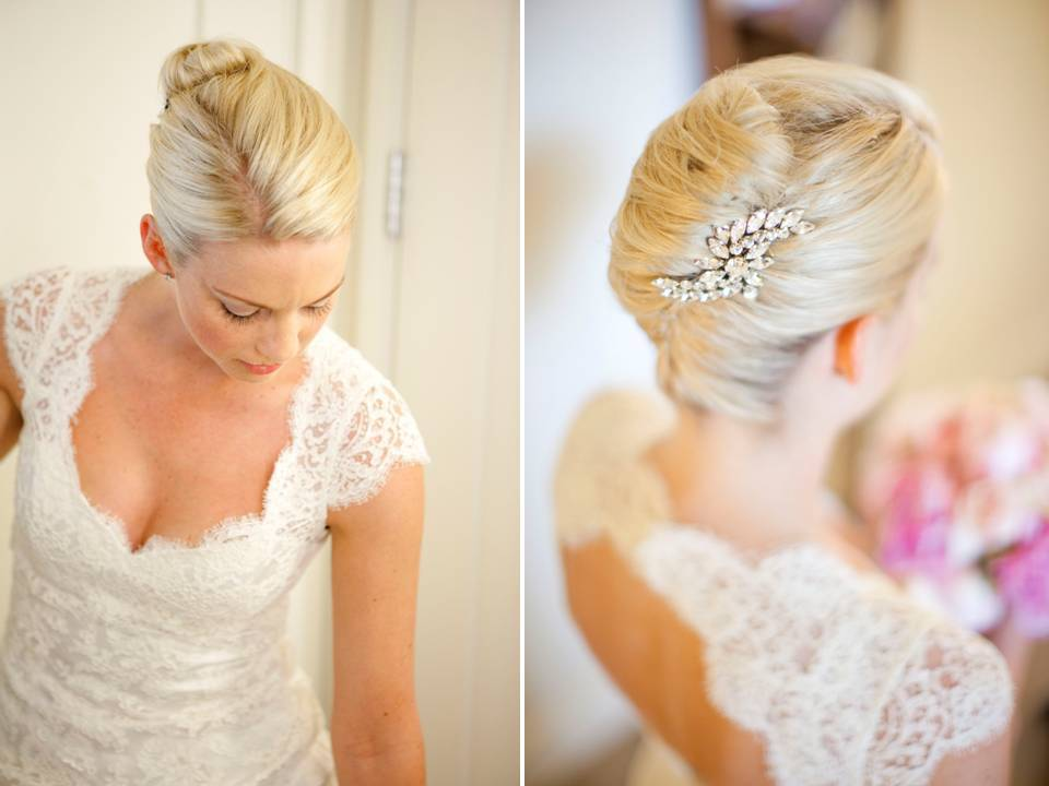 California bride wears ivory lace wedding dress and sleek chignon wedding hairstyle