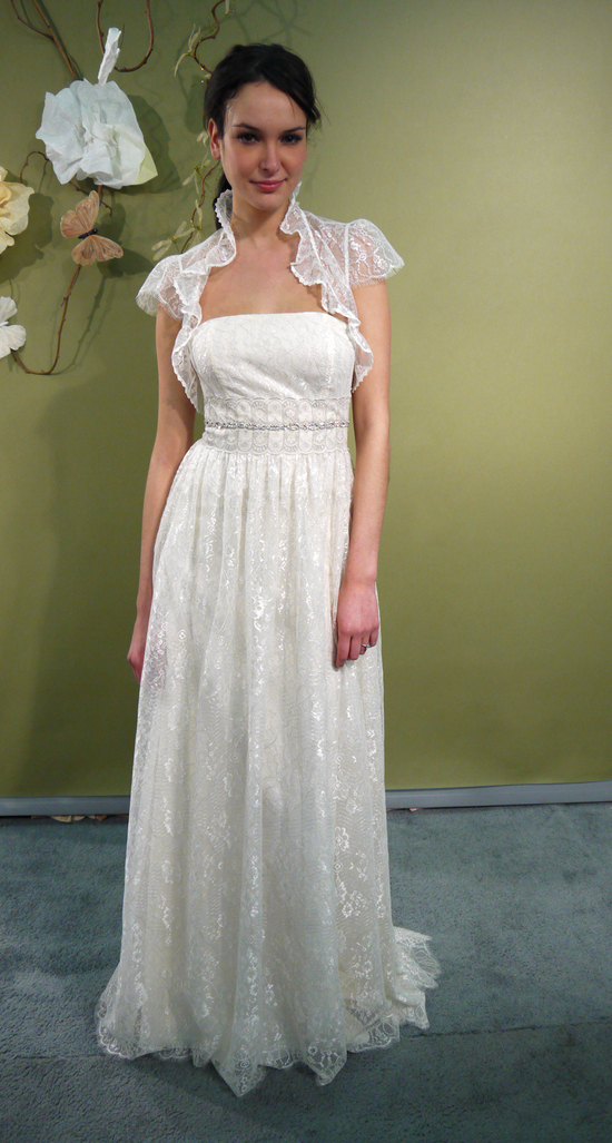 Simple and romantic lace column strapless bridal gown with sheer lace cap sleeved bolero
