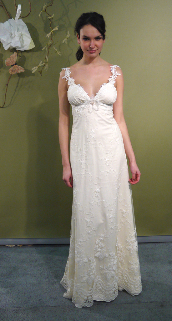 Ivory lace modified a-line deep v-neck wedding dress with embellished straps by Claire Pettibone