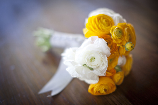 Bright and cheerful summer bridal bouquet of yellow and white ranunculus