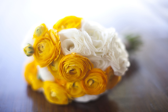 Sunny yellow and white ranunculus bridal bouquet for spring and summer weddings