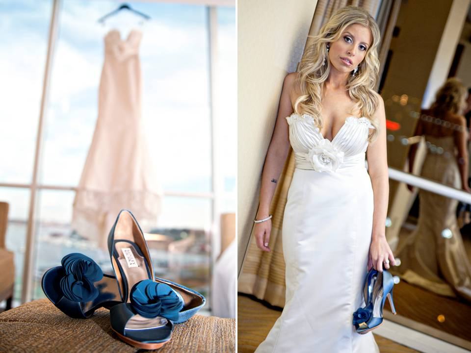 Ivory lace wedding dress hangs in window of wedding venue for Blue shoes for wedding dress