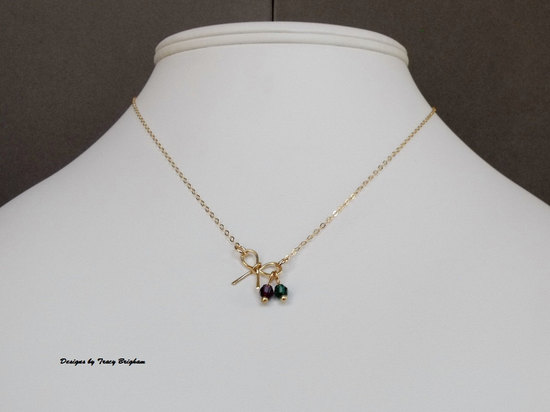 14k gold filled bow necklace personalized with birthstones