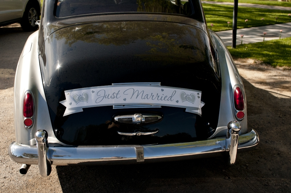 Vintage Rolls Royce wedding day transportation with Just Married! Sign on back