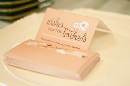 White dove design adorns peach wedding reception escort cards