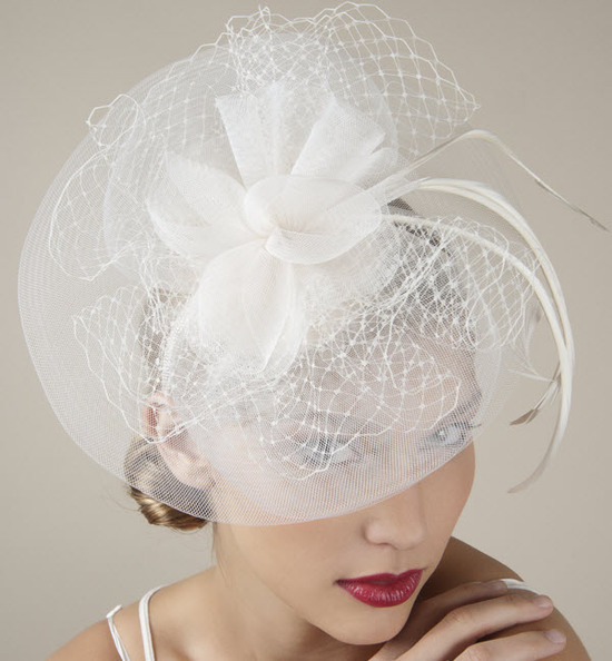Dramatic ivory bridal headband and fascinator with tulle, French net and a silk ivory flower
