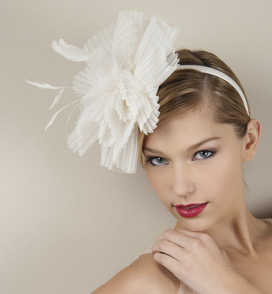 Couture-inspired bridal headband with oversized ivory flower