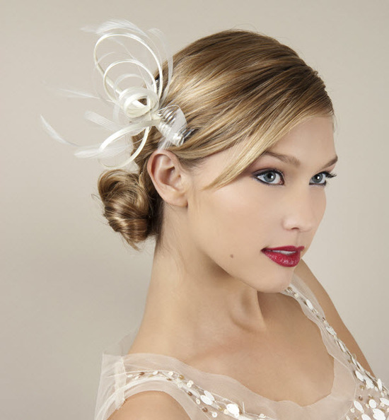 Simple and chic wedding hair barrette with looped feather design