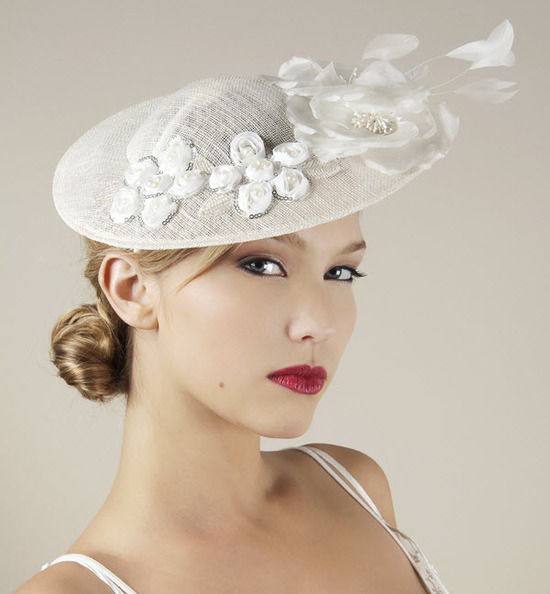 Chic white royal wedding hat with floral applique, feathers and beading