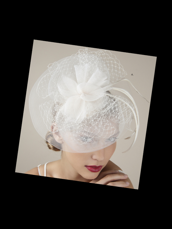Royal wedding-inspired ivory bridal fascinator and blusher