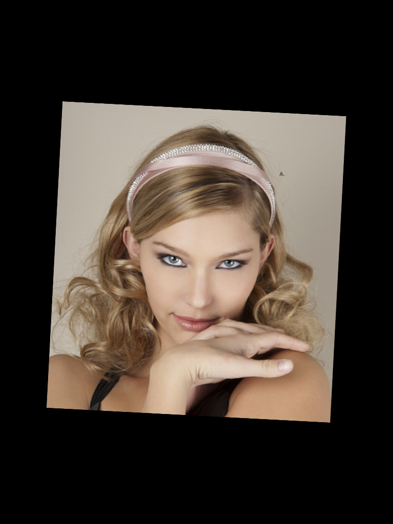 photo of Soft romantic wedding hairstyle accented with blush pink satin and rhinestone bridal headband