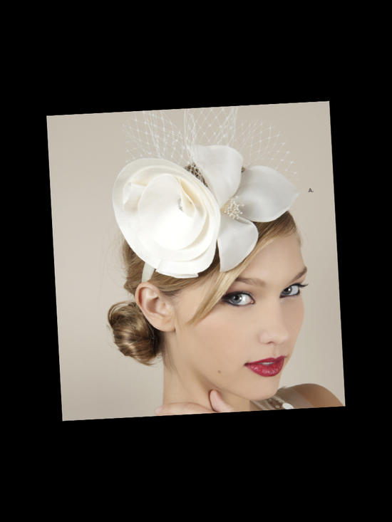Chic ivory mini bridal hat with French net and satin flower