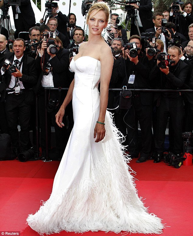 Celebrity-wedding-inspiration-red-carpet-bridal-gowns-white-versace-feathers-cannes-2011.full