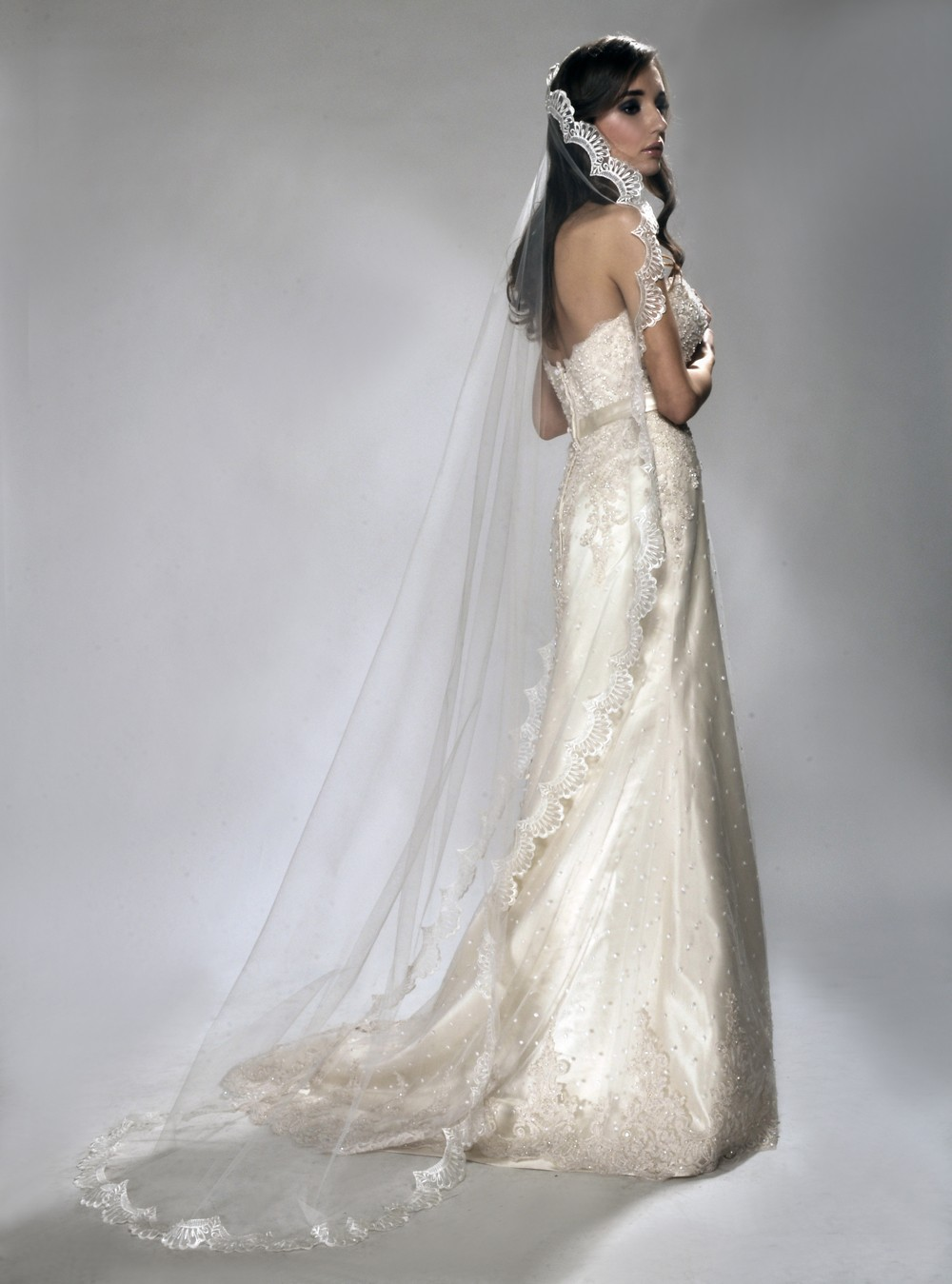 Romantic style bride wears chapel length mantilla style for Wedding dress with veil