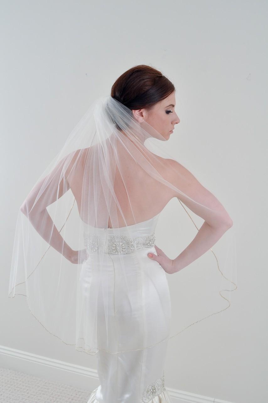 Fingertip-bridal-veil-sheer-tulle-bridal-updo-wedding-hairstyle.full