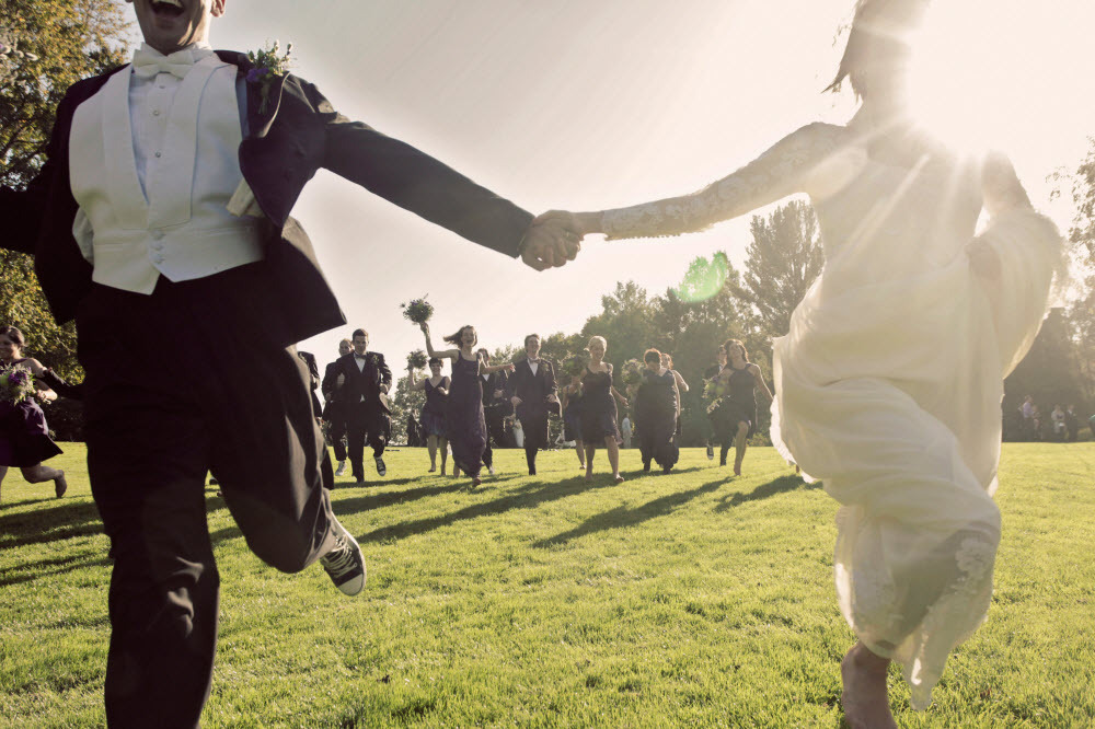 Funky-bride-and-groom-vintage-chic-wedding-style-play-with-bridal-party-on-golf-course-of-wedding-venue.full